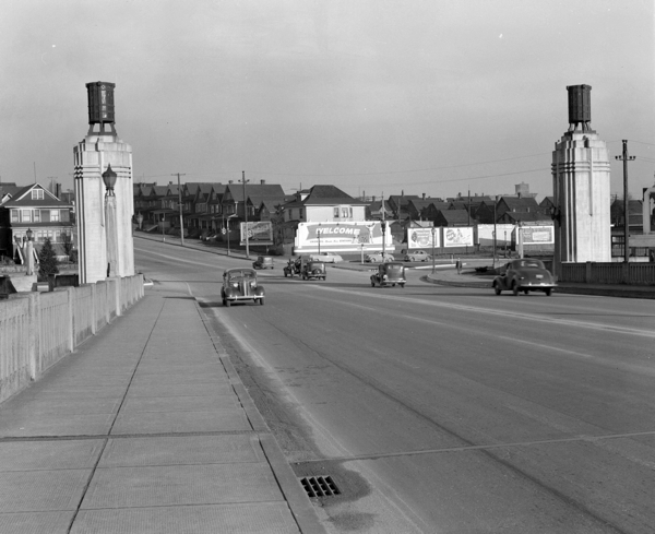 1940-1948 - [View of the north end of the Burrard Street Bridge showing billboards and houses along Pacific and Burrard] - AM1184-S1-- CVA 1184-1697